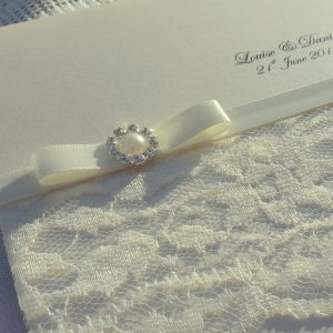 ivory lace and pearls wedding invitation