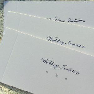 white sparkle cheque book invitations