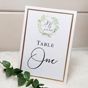 wedding table name card with greenery wreath