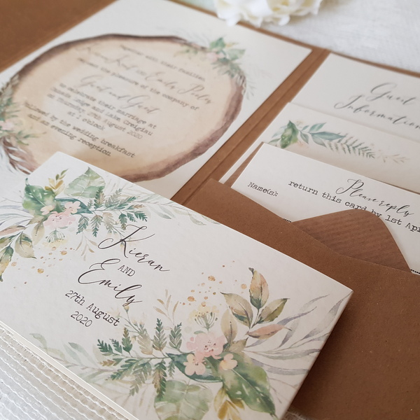 rustic pocketfold wedding invitation with log slice design and pretty flowers