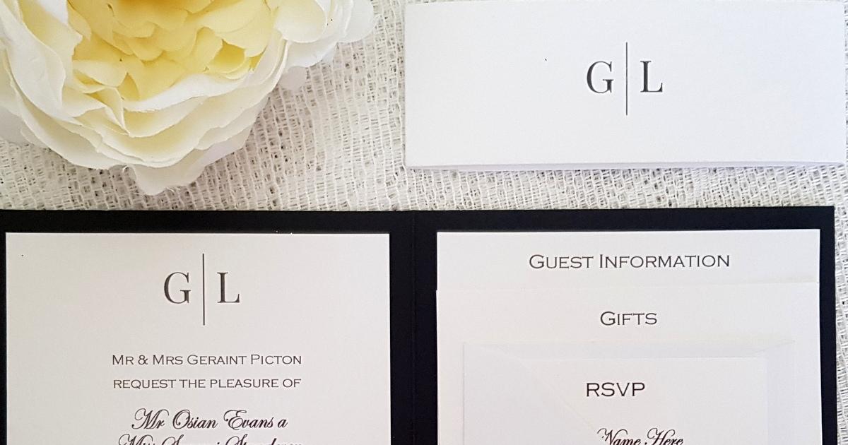 Elegant black and white handmade wedding invitation with a modern  monogram design