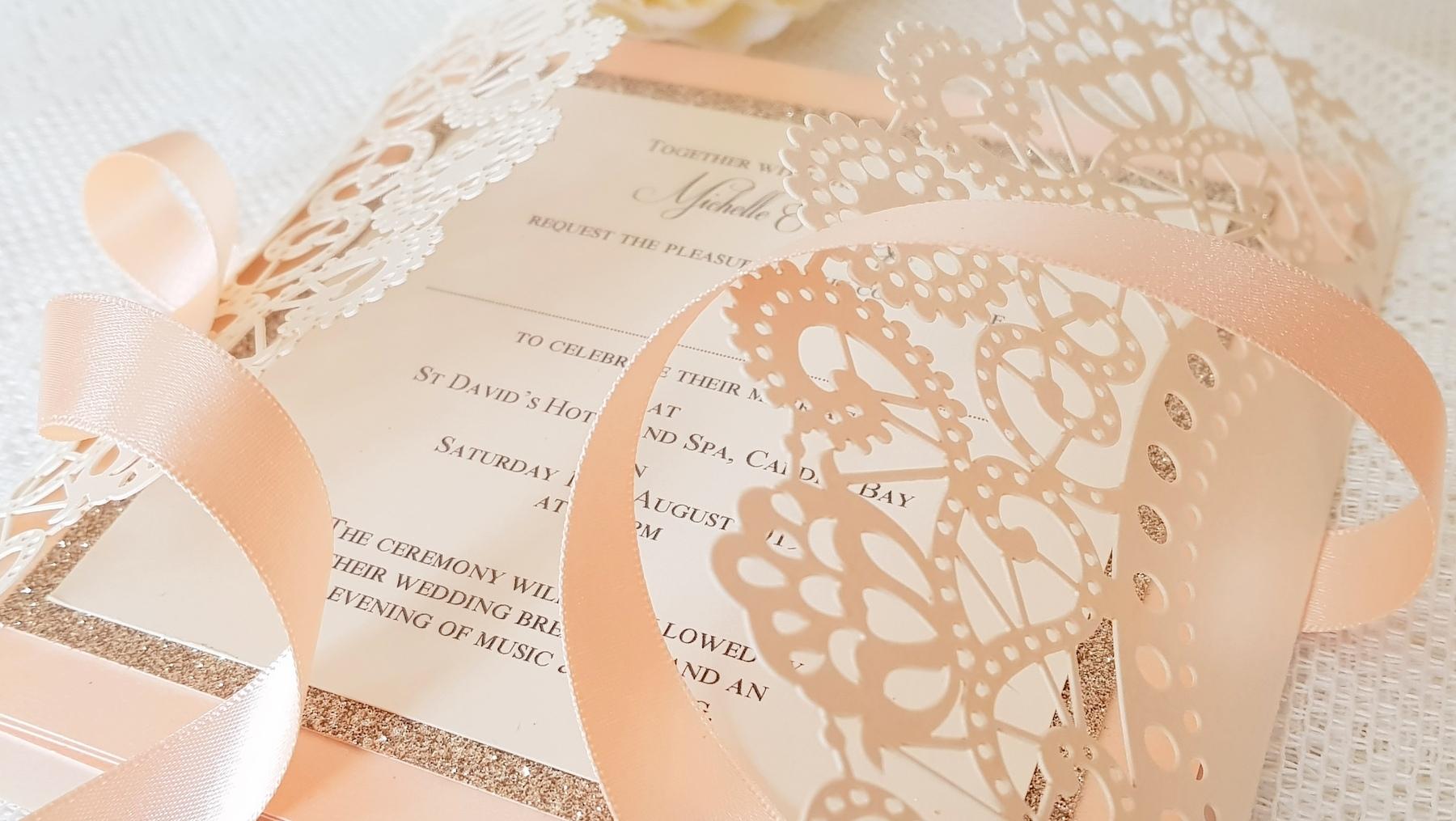 peach and gold glitter laser cut handmade wedding invitation