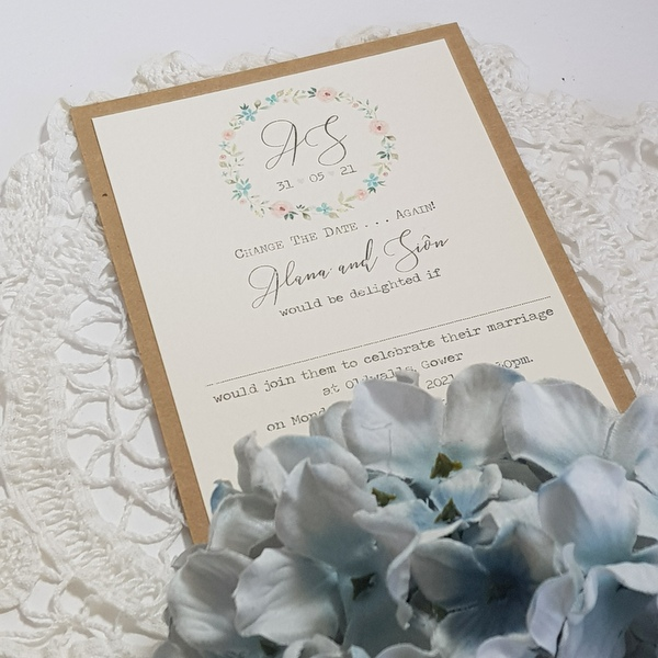 rustic floral wedding postponement card