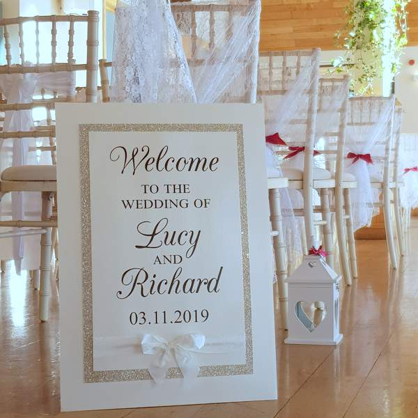 bespoke wedding welcome sign with glitter and a silk bow