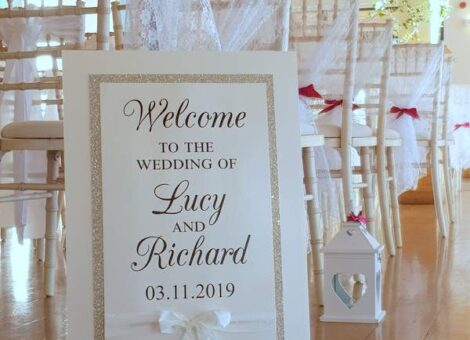 bespoke wedding welcome sign with glitter and a bow