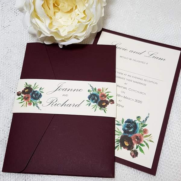 burgundy pocketfold invitation with floral design