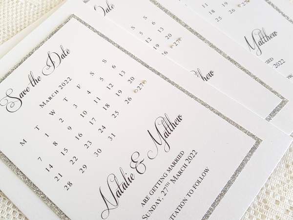 Elegant white and silver glitter calendar style handmade save the date cards