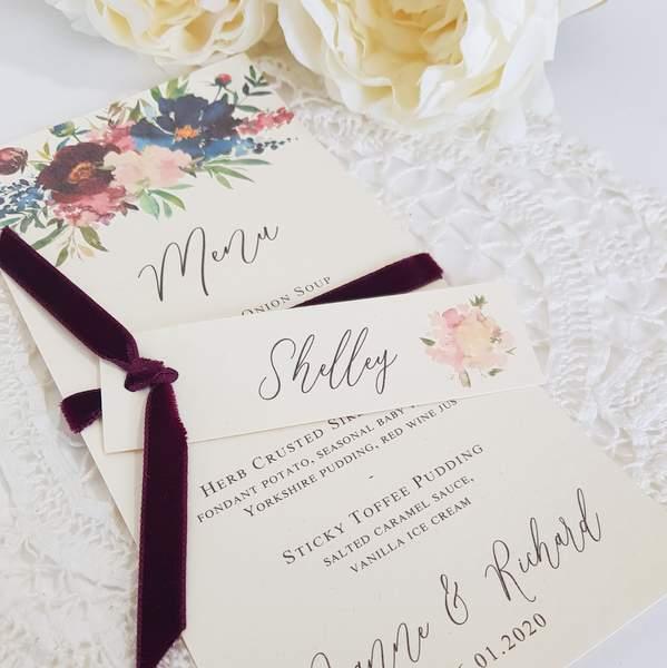 handmade wedding menu with burgundy ribbon