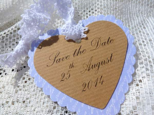heart shaped save the date card with kraft card and lace