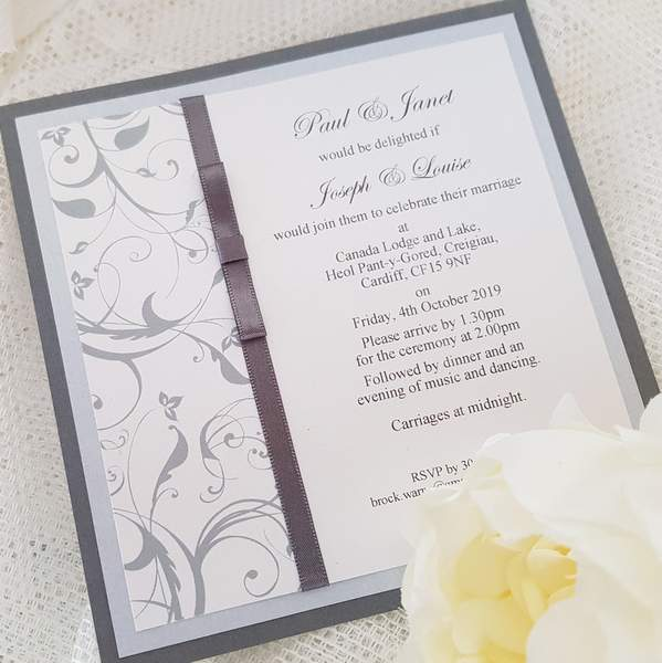 grey and silver invitations with wedding details