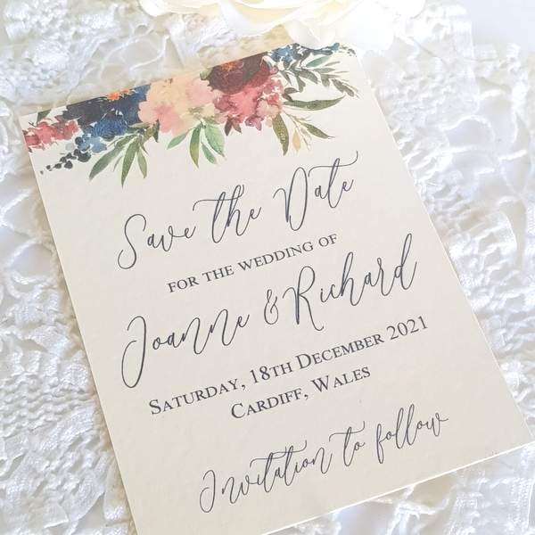 wedding save the date card with a burgundy and navy watercolour floral design