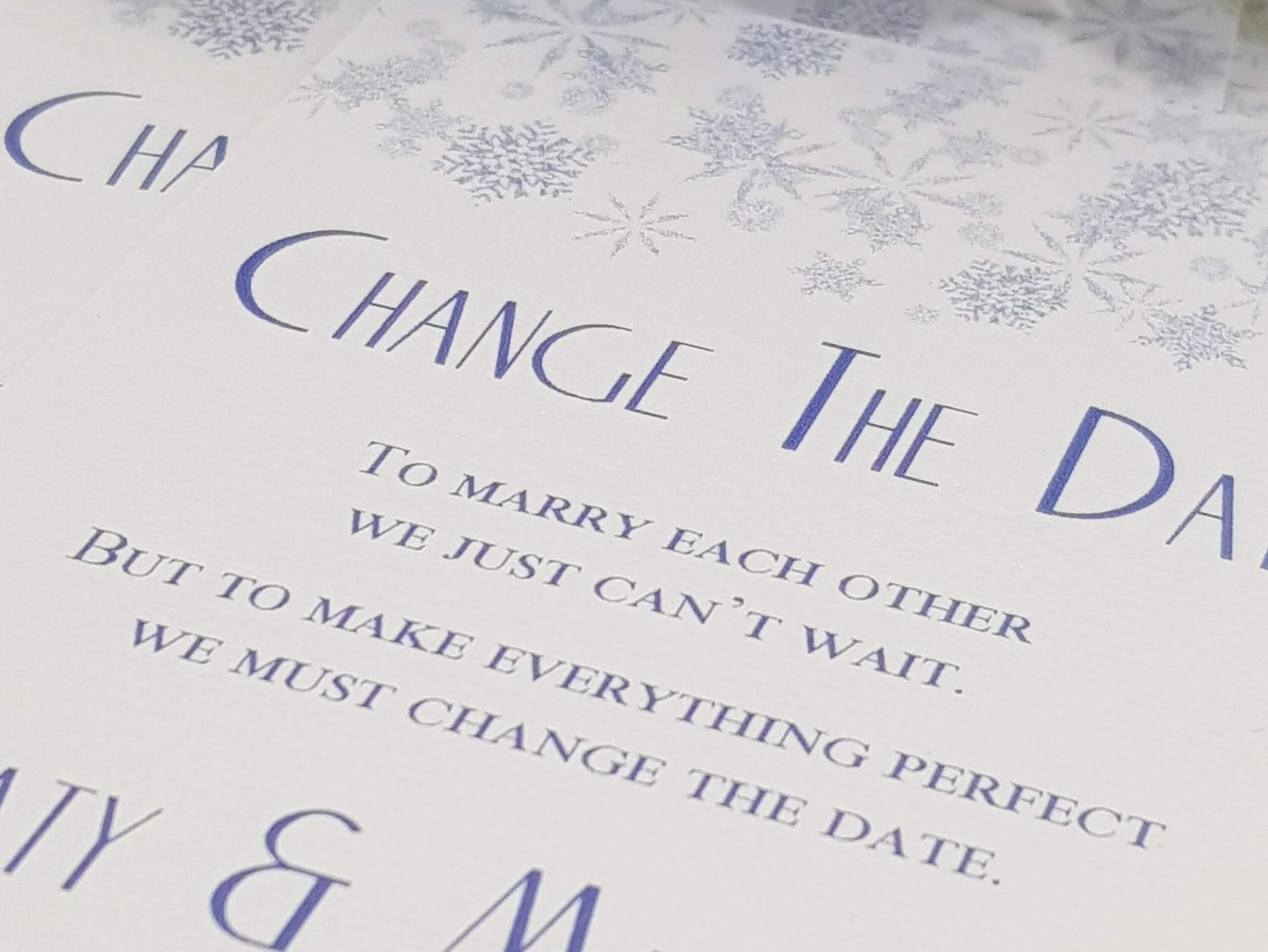 handmade wedding postponement card with snowflake design