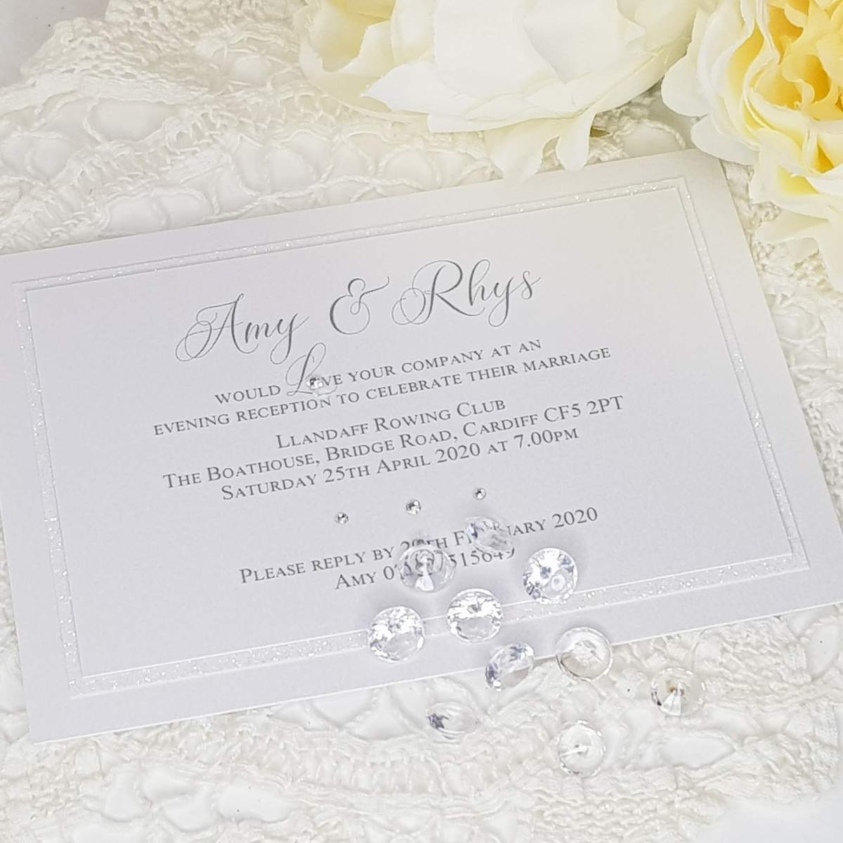 Chic white evening invitation with glitter and crystal accents