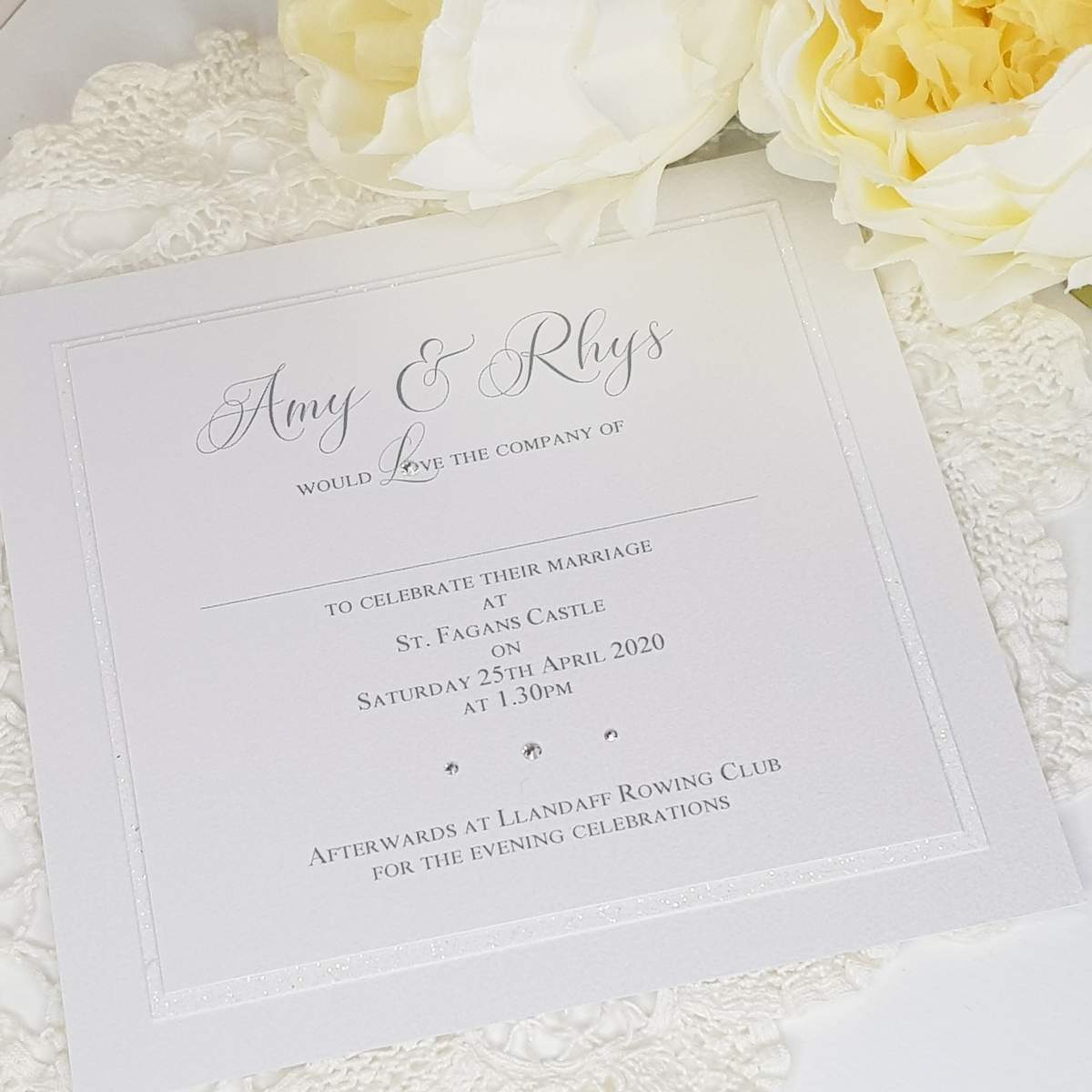 Elegant white handmade wedding invitations with crystals and glitter