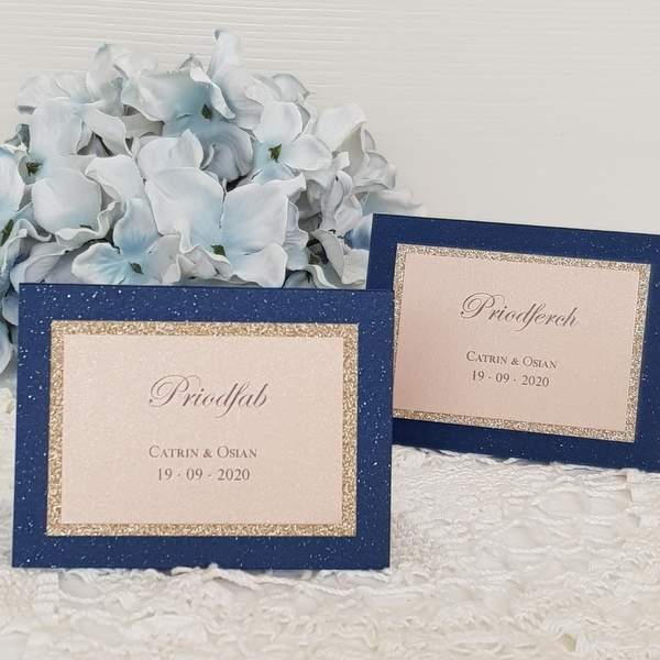 Navy blue and blush personalised wedding place cards, Welsh language
