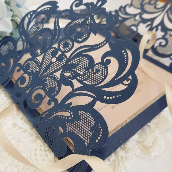 Navy and blush handmade laser cut wedding invitations