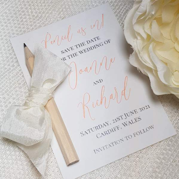 pretty pencil us in wedding save the date card with ivory ribbon bow