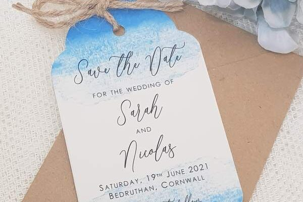 rustic coastal save the date card, luggage tag style with twine