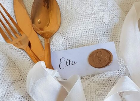 elegant calligraphy place tag with a gold wax seal