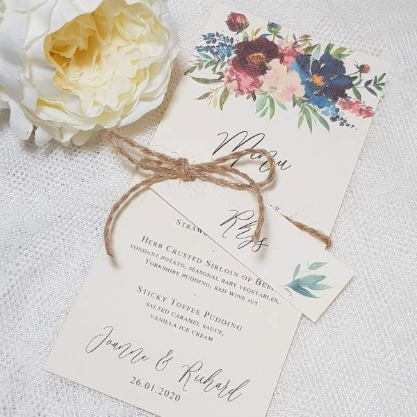 Burgundy and navy floral wedding menu with name tag attached with twine