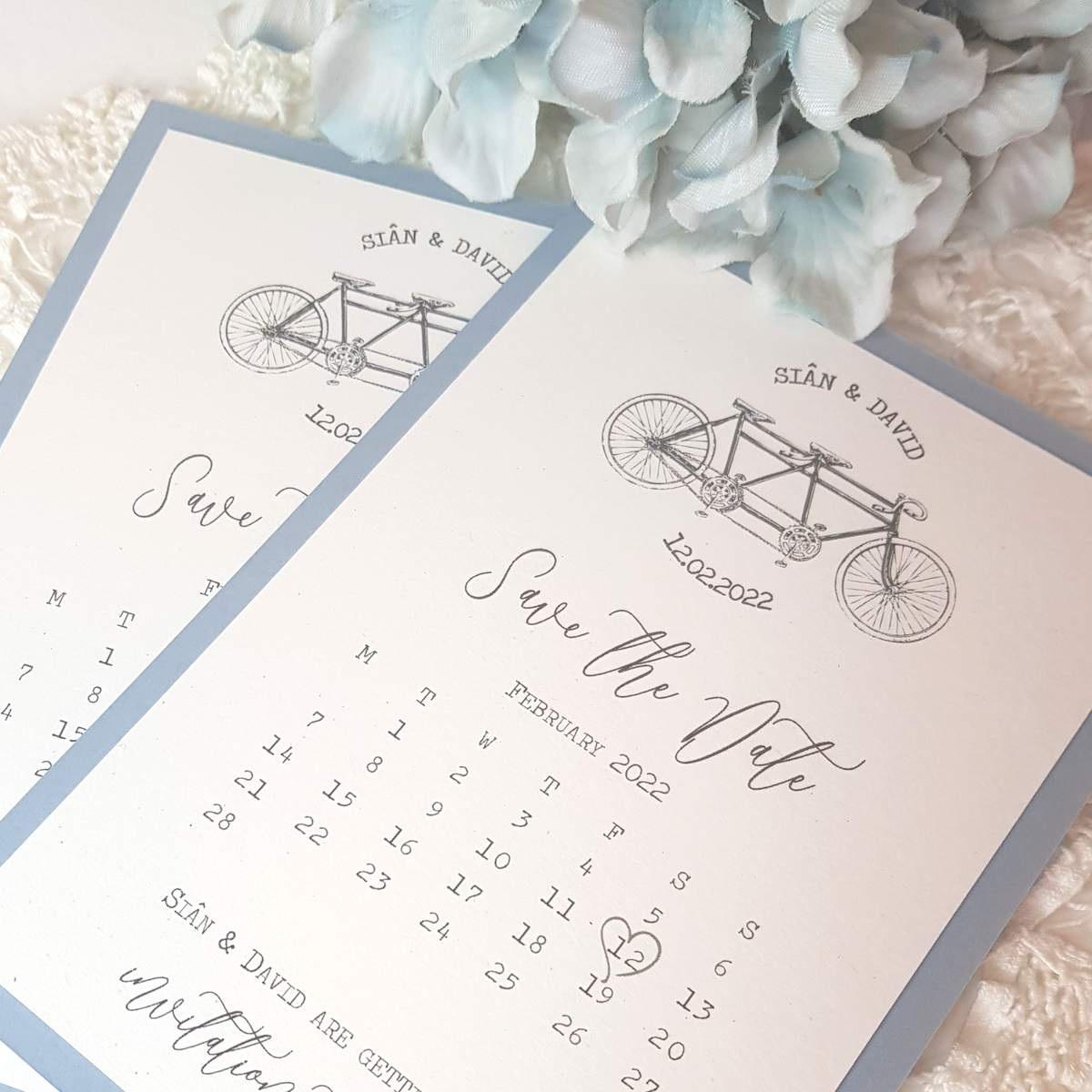 Pretty save the date card with a calendar print and tandem design