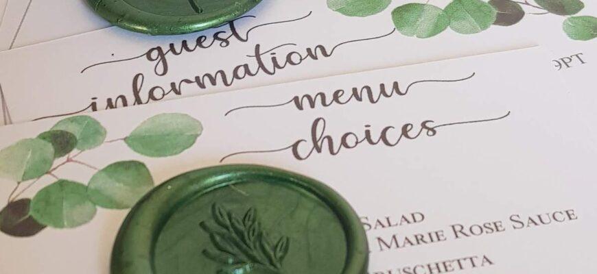 elegant wedding invitation with eucalyptus design and green wax seals