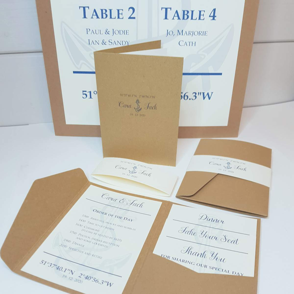 recycled kraft wedding stationery with a navy anchor design