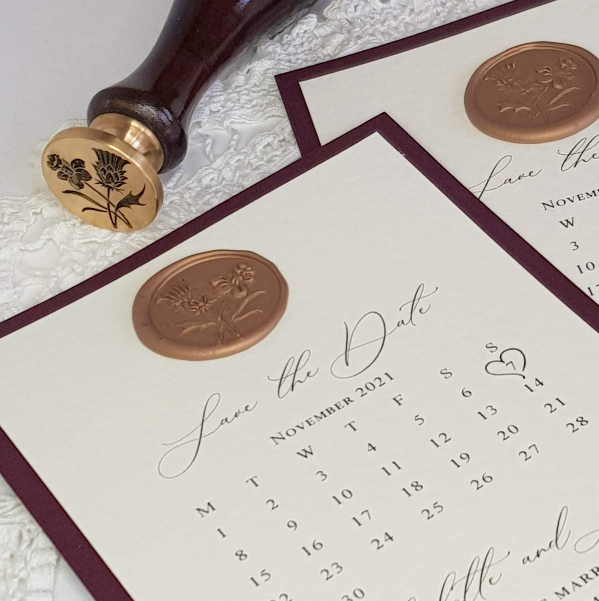calendar style save the date card with a gold wax seal