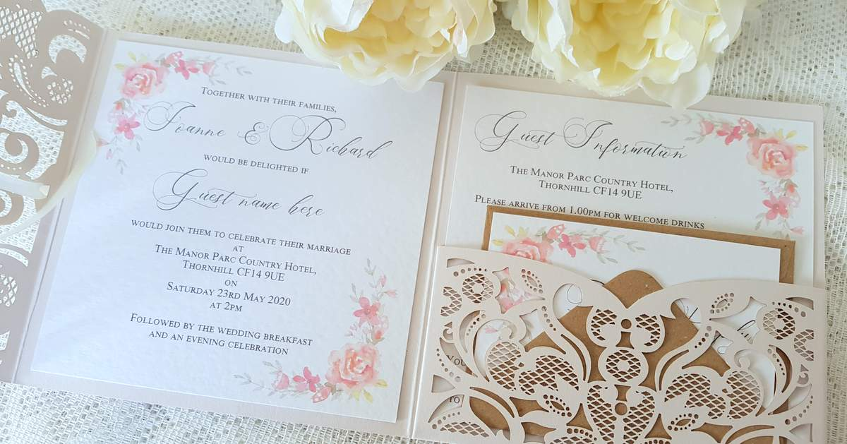 pretty laser cut coral wedding invitation with watercolour flowers
