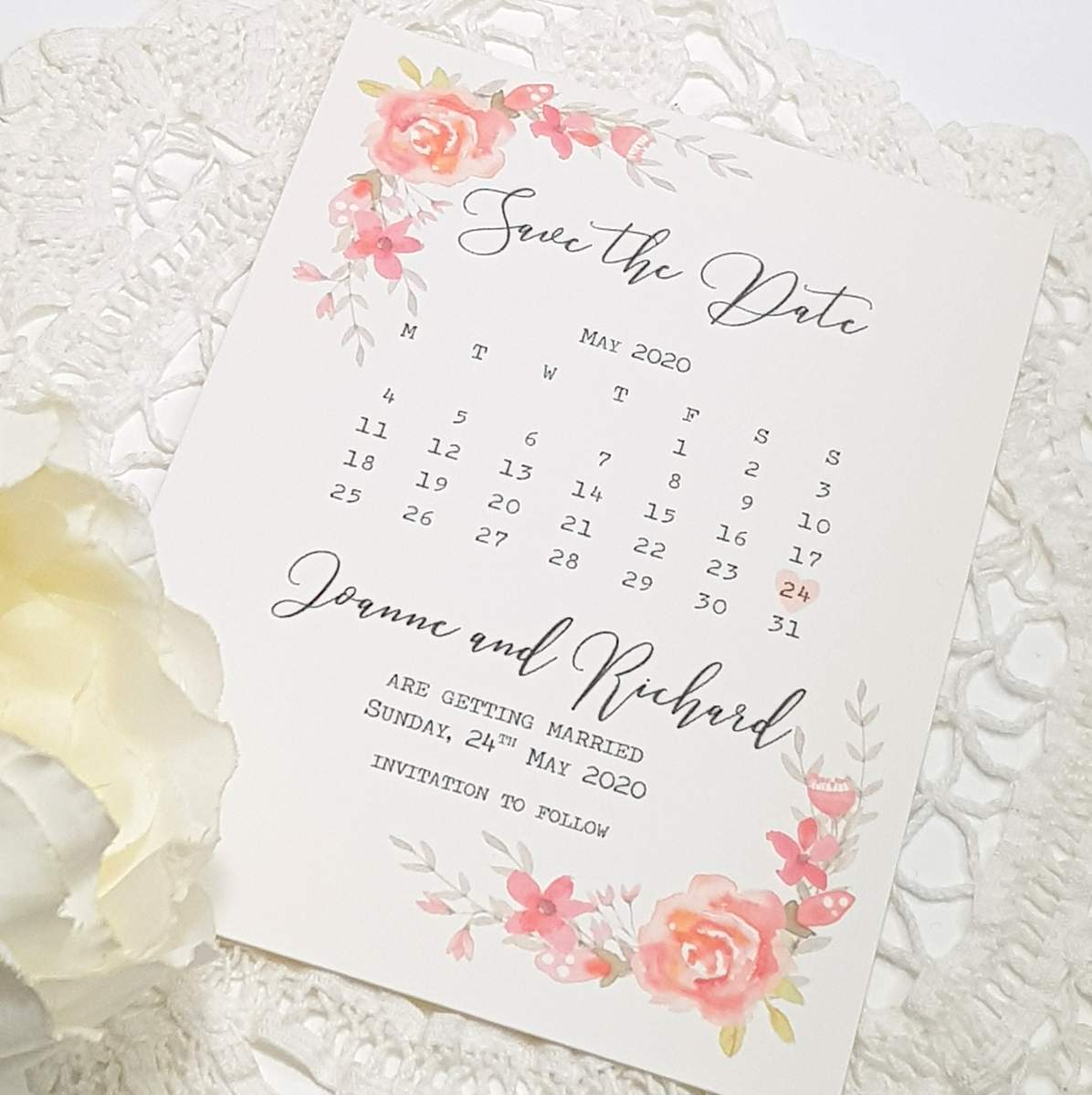 wedding save the date card with pretty pink and coral roses
