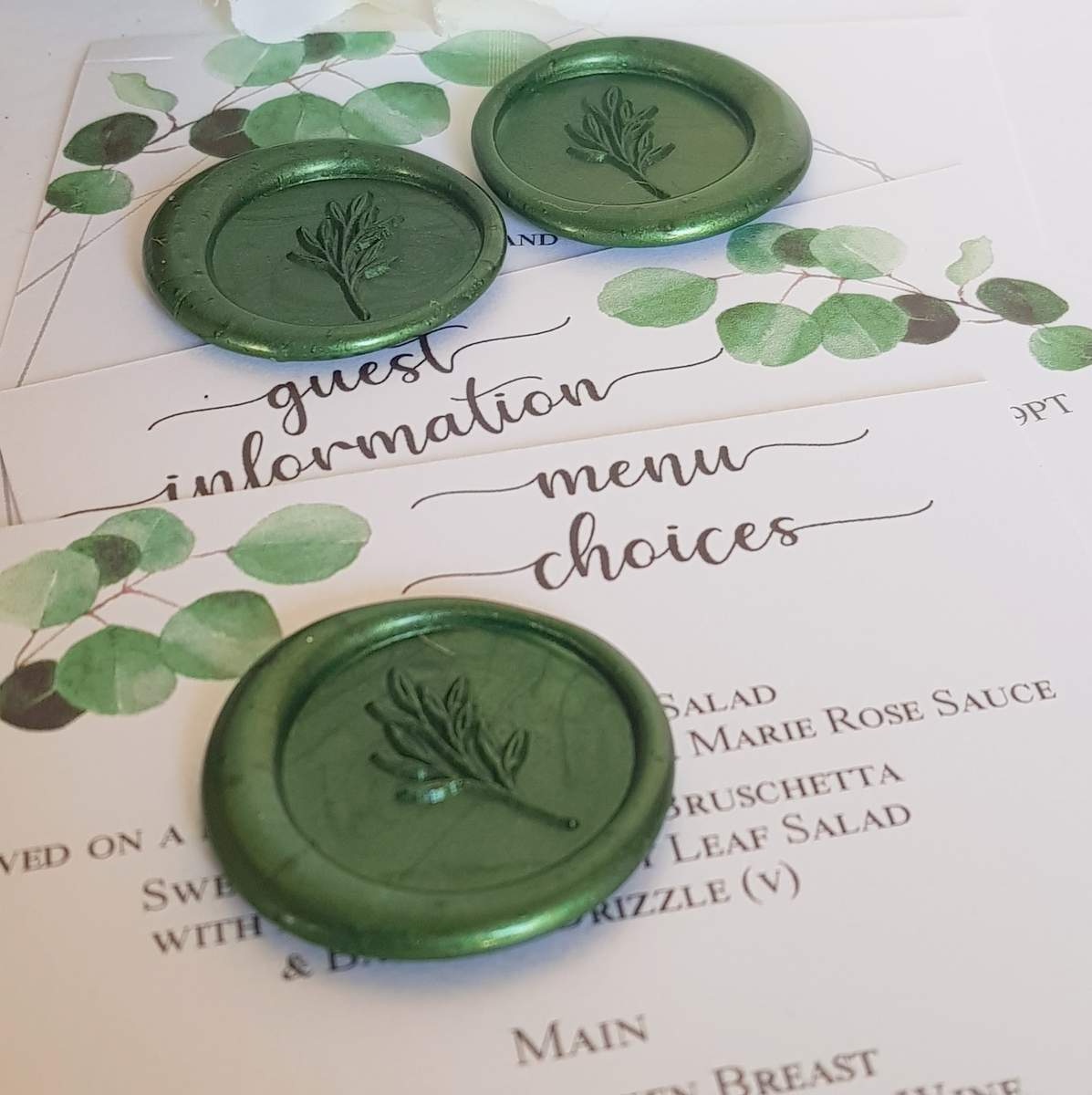 wax seals and extra inserts in a wedding invitation, all factors that will affect how much do wedding invitations cost