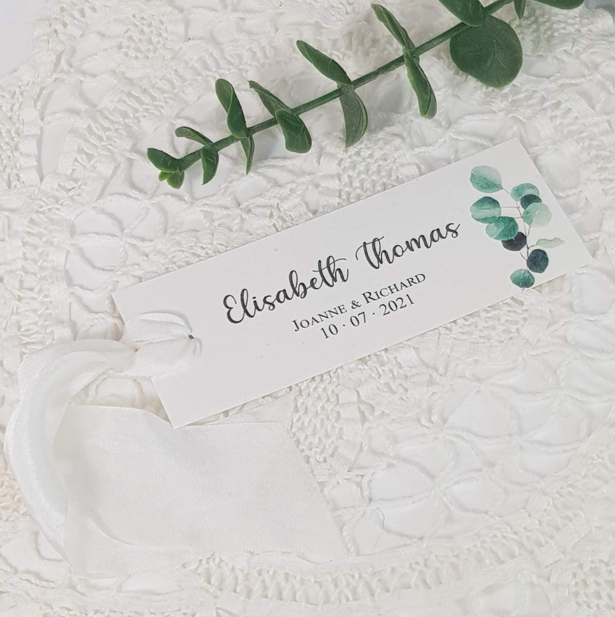 wedding place card with a eucalyptus print and silk ribbon