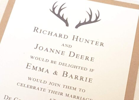 a wedding invite with a striking stag antlerl design