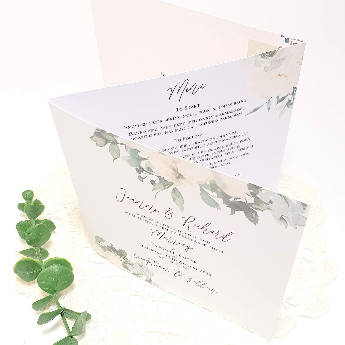 concertina wedding invitation with a pretty greenery and white floral design