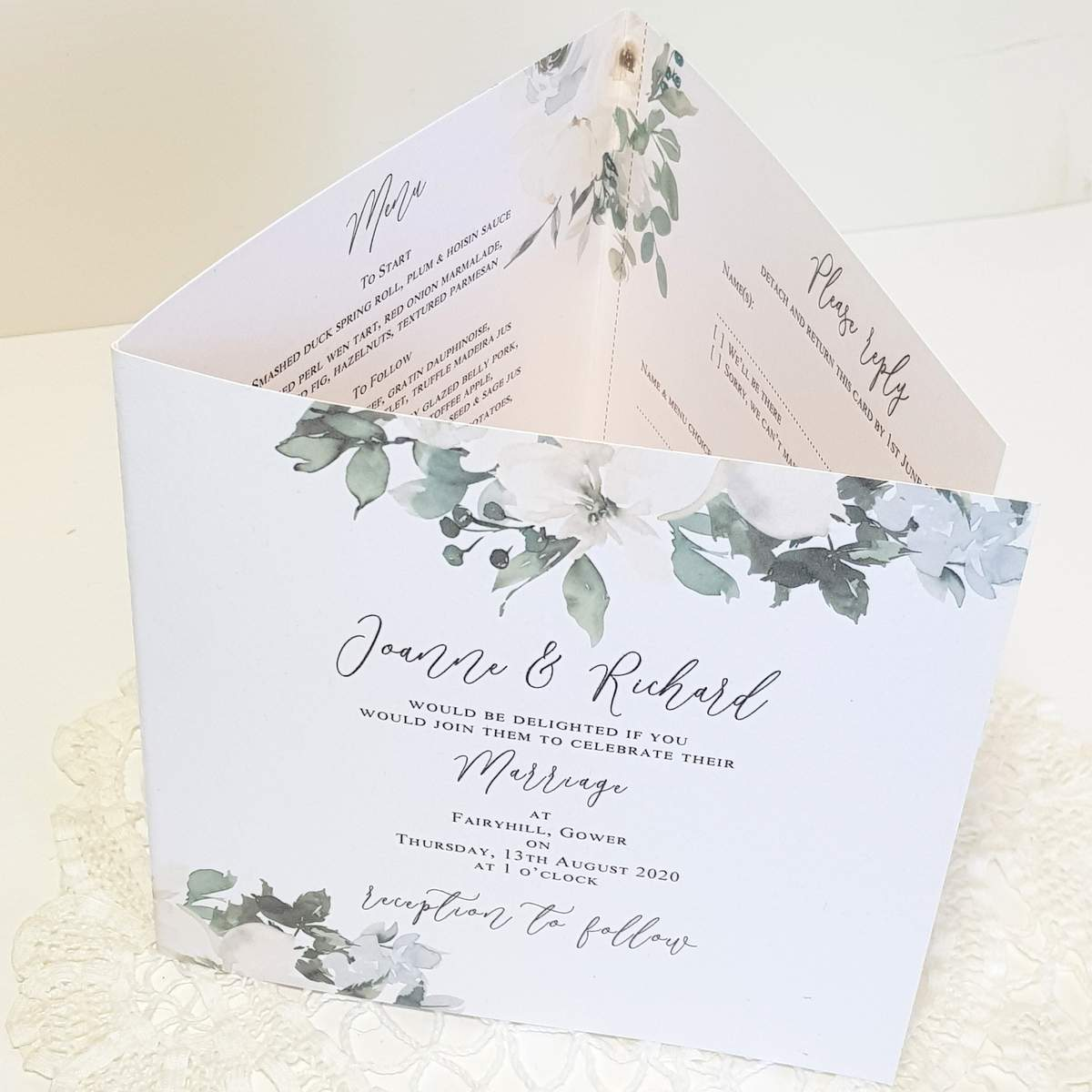 concertina invitation with white flowers