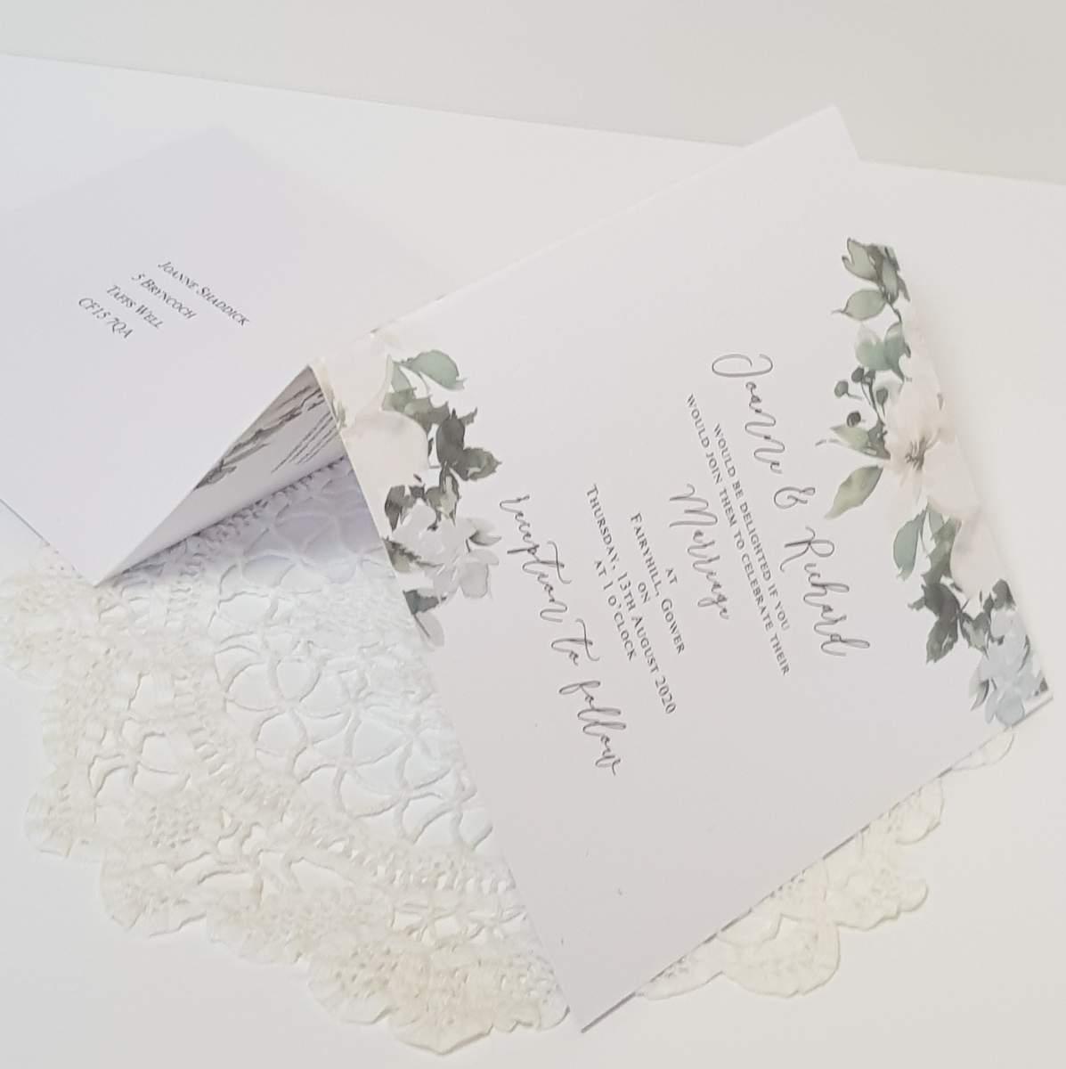white floral concertina invitation