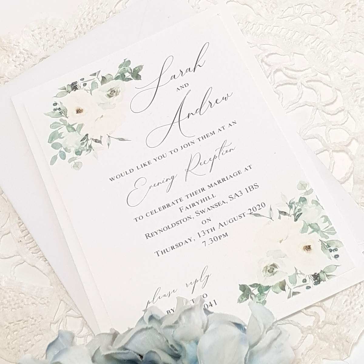 a pretty white and green flowery eco friendly wedding invite