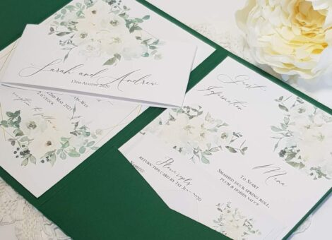 green pocketfold invitation with white floral inserts