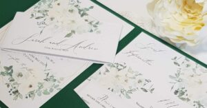 pocketfold wedding invitation with green and white flowers