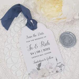 white floral save the date tag with silk ribbon