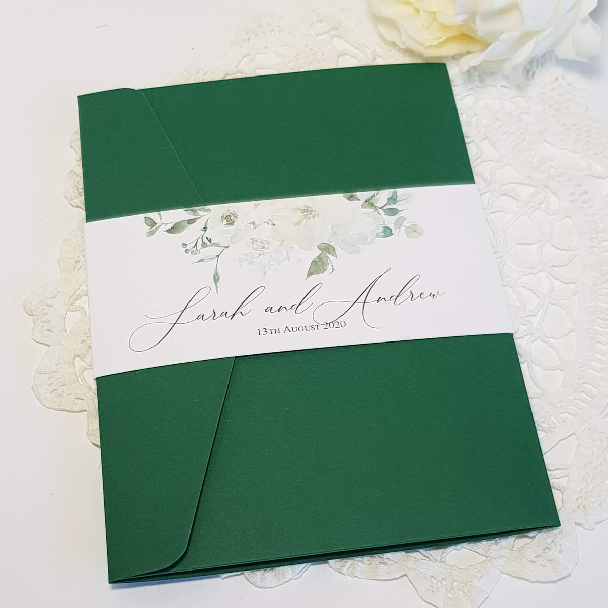 green and white pocket invitation with a bellyband