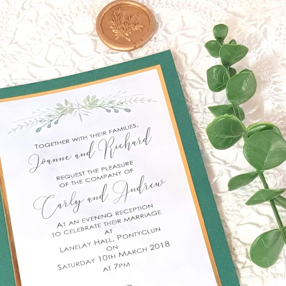 flat wedding invitation with greenery design