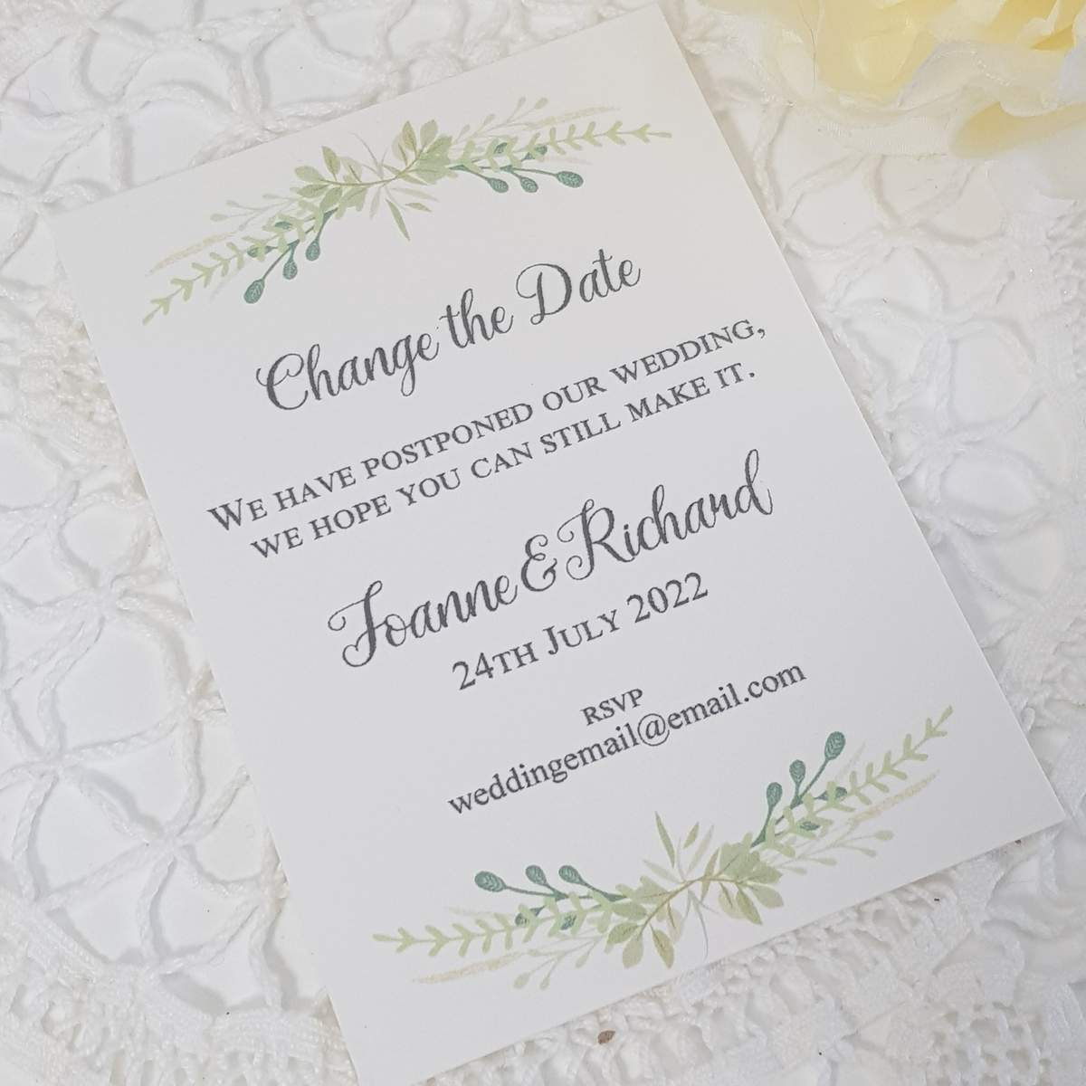wedding change the date with greenery