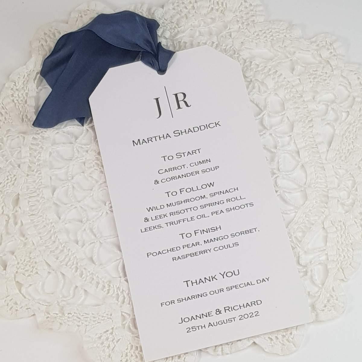 tag style personalised wedding menu with dark grey silk ribbon