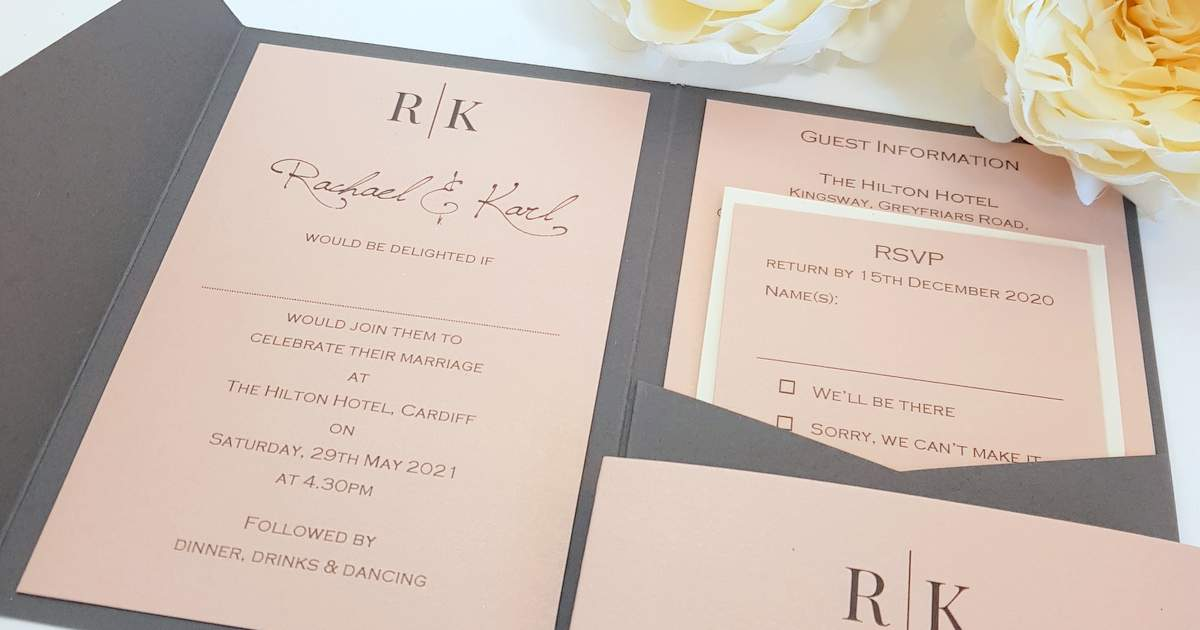 an open pocketfold wedding invitation showing inserts in grey and blush pink