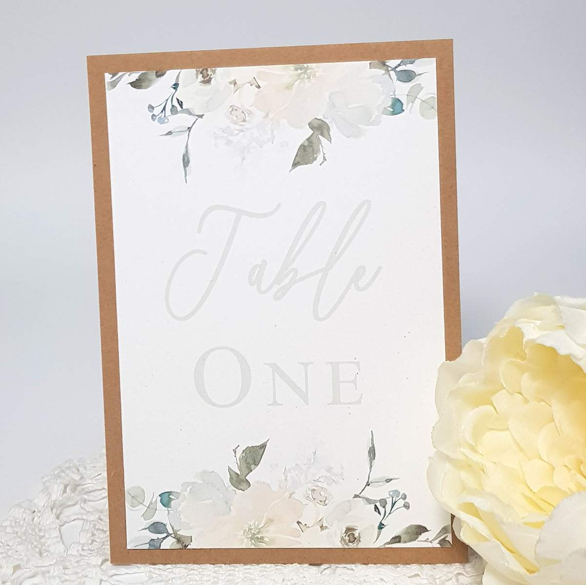 wedding table number with white floral design and rustic kraft card border