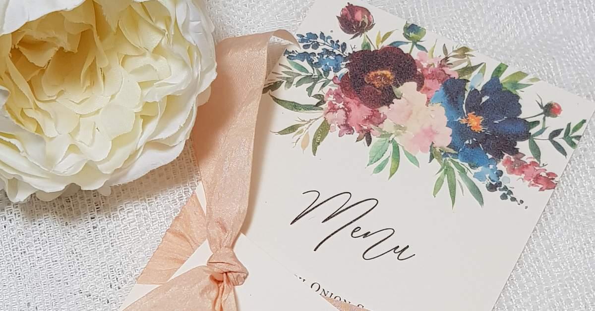 floral wedding menu card with peach silk ribbon