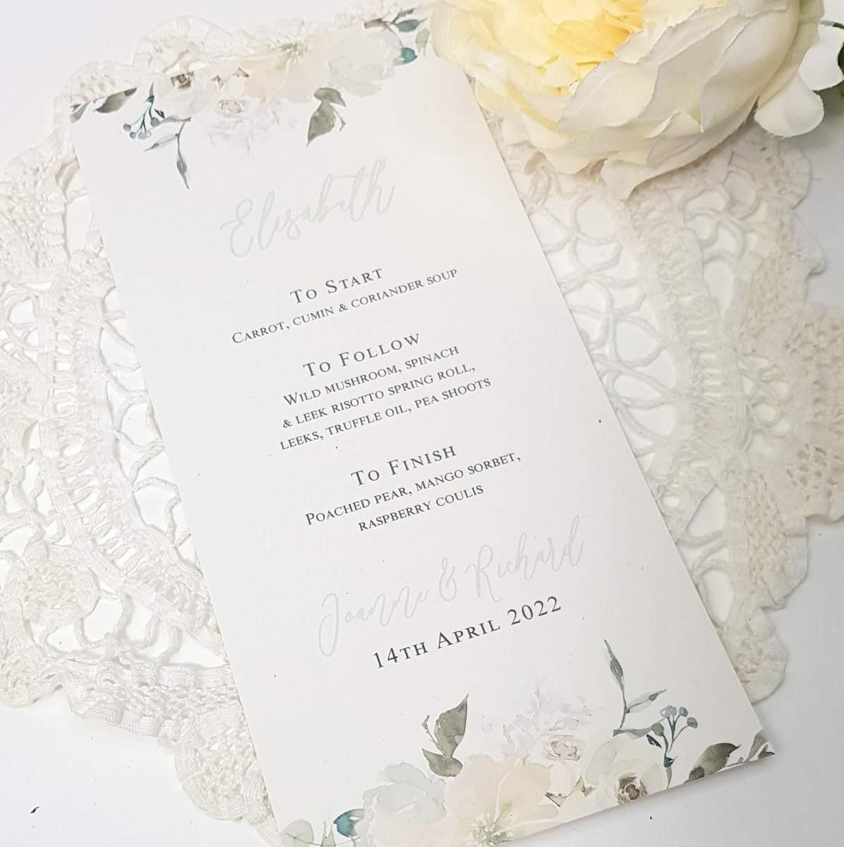personalised wedding menu with white flowers