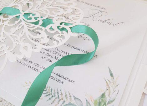 laser cut wedding invitation with woodland foliage design
