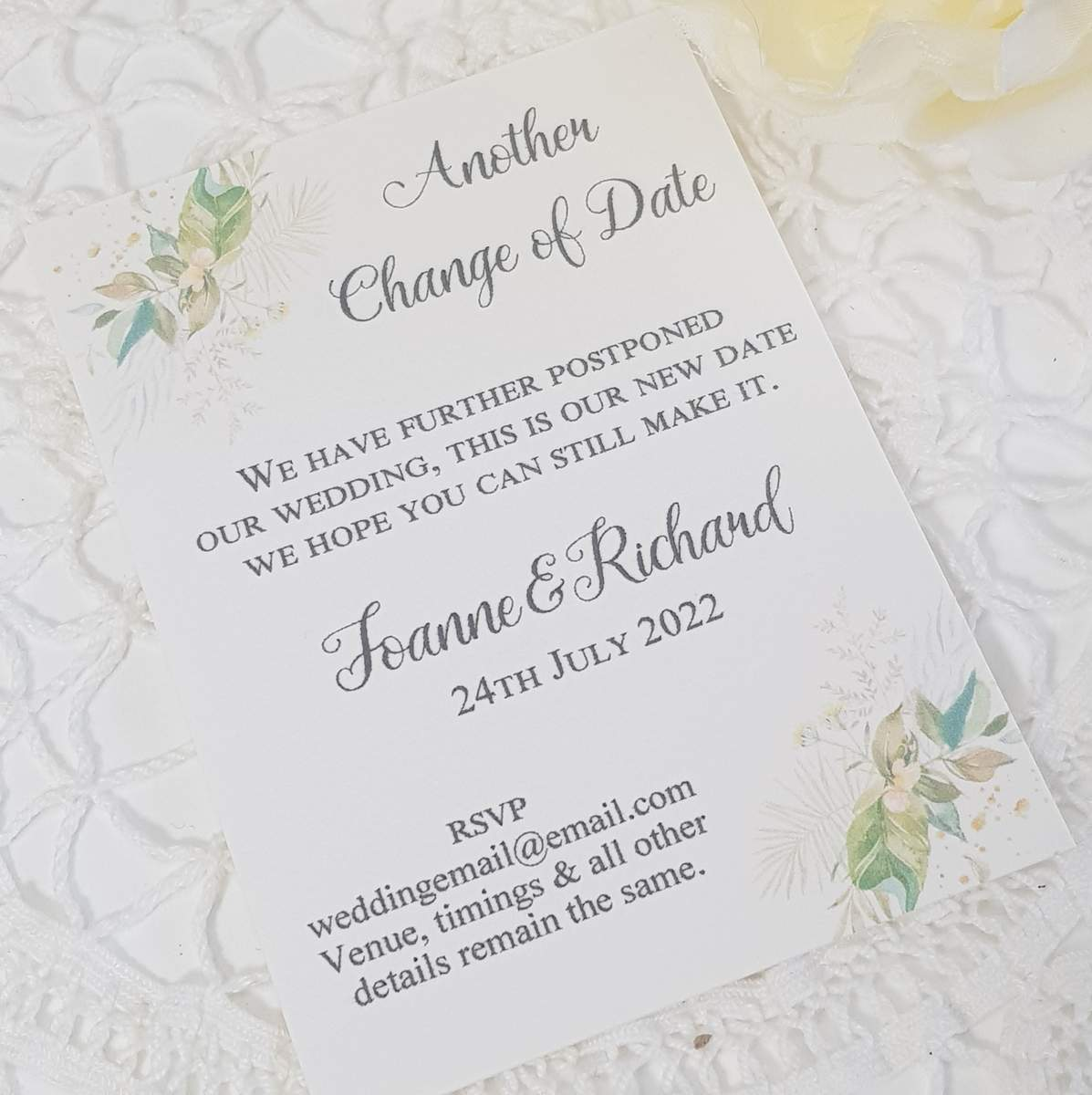 wedding change the date card with woodland foliage and ferns design